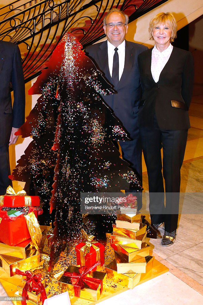 Professor David Khayat of which the auction will benefit his foundation 'AVEC' and MarieChristiane Marek are pictured in front of Christmas Tree from...