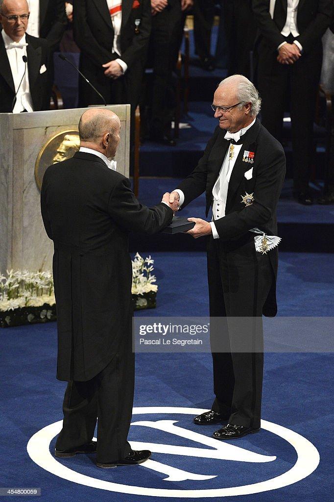 Professor Eugene F. Fama (L), laureate of The Sveriges Riksbank Prize in Economic Sciences in Memory of Alfred Nobel receives his Nobel Prize from King Carl XVI Gustaf of Sweden (R) during the Nobel Prize Awards Ceremony at Concert Hall on December 10, 2013 in Stockholm, Sweden.