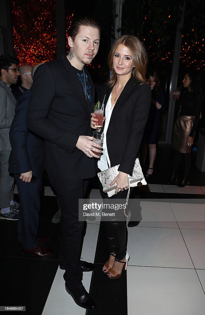<a gi-track='captionPersonalityLinkClicked' href=/galleries/search?phrase=Professor+Green&family=editorial&specificpeople=6919860 ng-click='$event.stopPropagation()'>Professor Green</a> and Millie Macintosh attend Esquire's 'The Big Black Book' launch party At Sushi Samba on March 26, 2013 in London England.