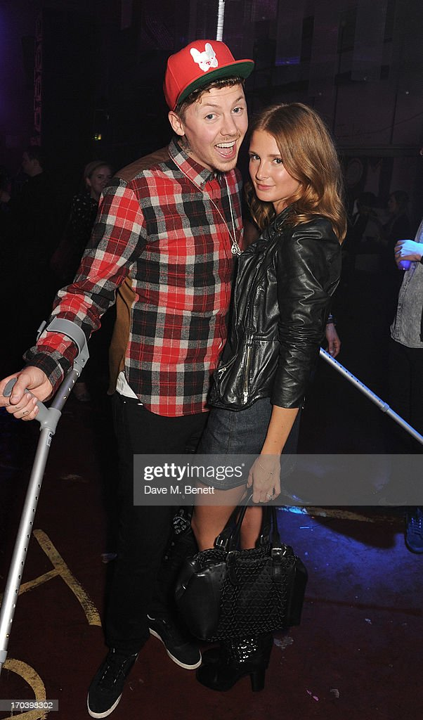 Professor Green (L) and Millie Mackintosh attend Club DKNY in celebration of #DKNYARTWORKS hosted by Cara Delevingne with special performances by Rita Ora and Iggy Azalea at The Fire Station on June 12, 2013 in London, England.