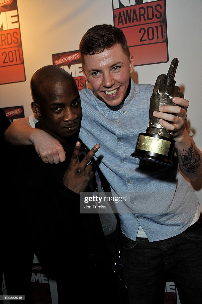 Professor Green (R) poses with his Best Dancefloor Filler award during the NME Awards 2011 at Brixton Academy on February 23, 2011 in London, England.