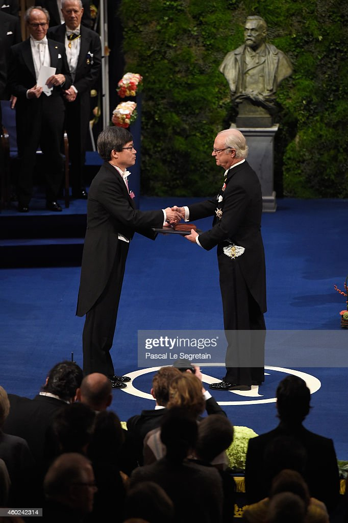 Professor Hiroshi Amano, laureate of the Nobel Prize in Physics receives his Nobel Prize from King Carl XVI Gustaf of Sweden during the Nobel Prize Awards Ceremony at Concert Hall on December 10, 2014 in Stockholm, Sweden.