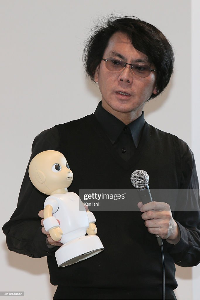 Professor Hiroshi Ishiguro speaks during the press conference to introduce the sociable robots, 'CommU' and 'Sota' hosted by only the robot science communicator Otonaroid and the robot anchor Kodomoroid at the National Museum of Emerging Science and Technology (Miraikan) on January 20, 2015 in Tokyo, Japan. CommU and Sota, developed to improve humanoids' sense of interaction in dialogue, make people feel more engaged in conversation with them by featuring diverse eye movements and gaze directions.