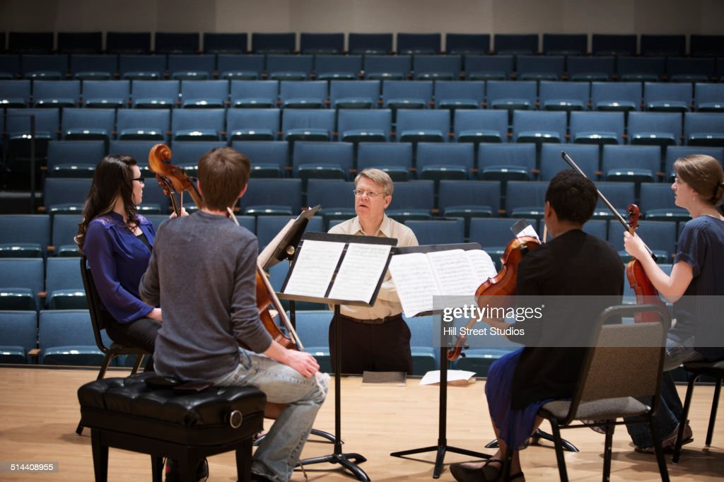 Professor instructing college string quartet