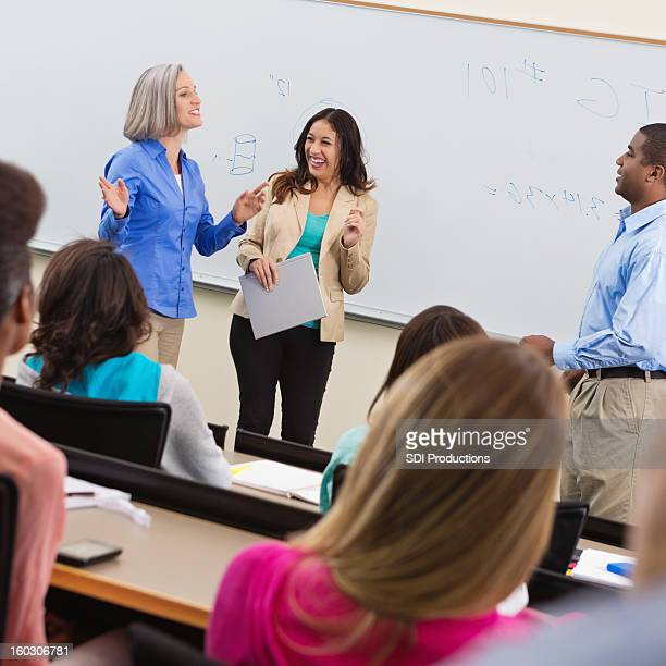 Professor introducing guest speaker in college lecture hall