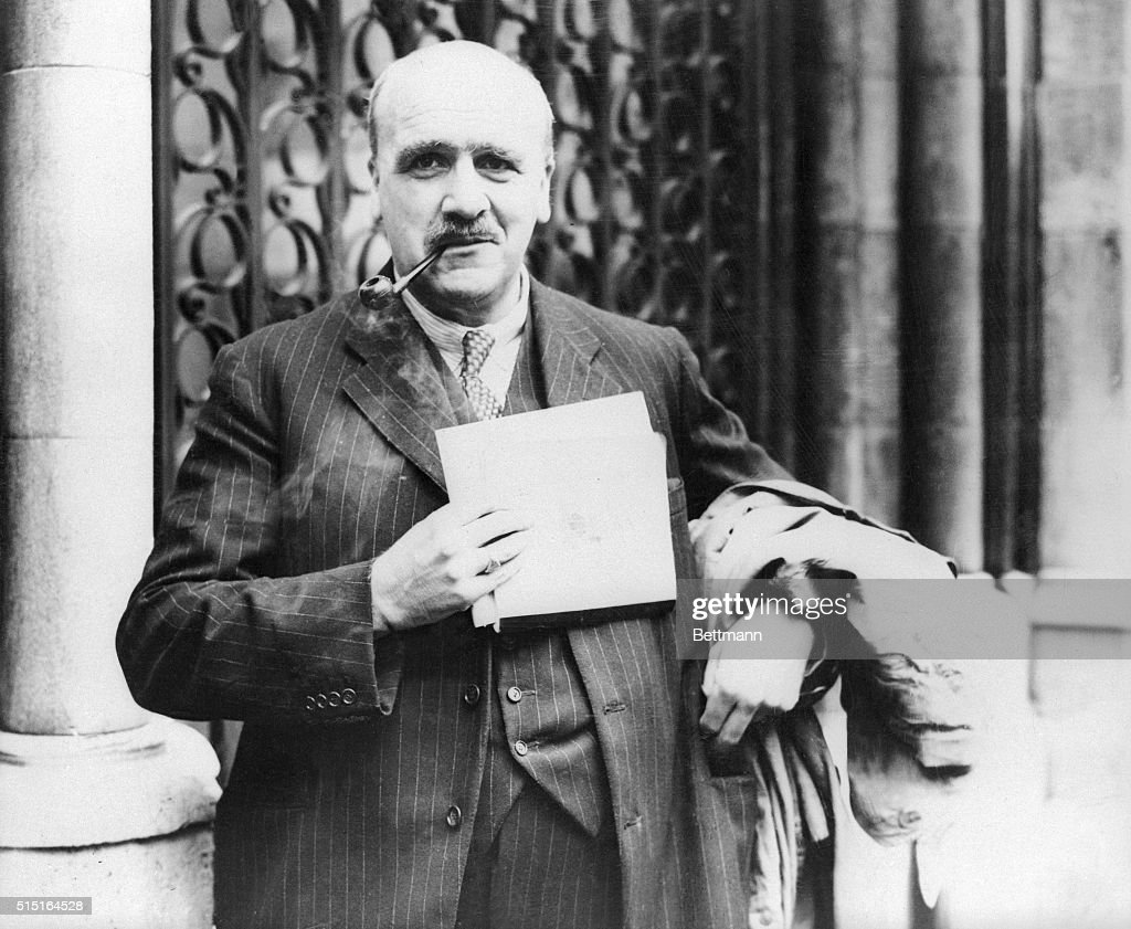 Professor J B S Haldane noted British scientist is shown leaving the Law Courts in London where he appeared before the Board of Inquiry probing the...