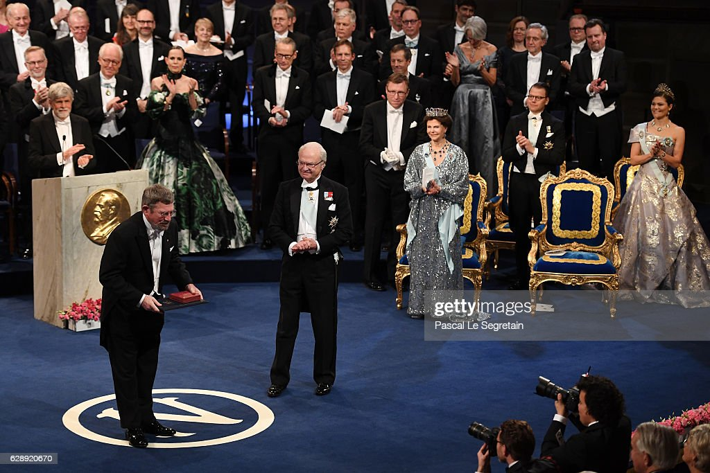 Professor J. Michael Kosterlitz, laureate of the Nobel Prize in Physics acknowledges applause after he received his Nobel Prize from King Carl XVI Gustaf of Sweden during the Nobel Prize Awards Ceremony at Concert Hall on December 10, 2016 in Stockholm, Sweden.