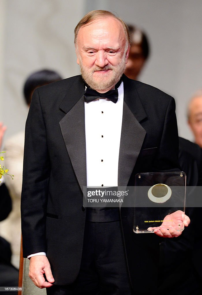 Professor Jean M. J. Frechet of the US holds his trophy during the awards ceremony for the Japan Prize in Tokyo on April 24, 2013. Frechet and his compatriot, Professor C. Grant Wilson, were jointly awarded the prize in the materials and production field to develop chemically amplified resistant polymer materials for the innovative semiconductor manufacturing process. The Japan Prize is awarded annually to scientists and engineers from around the world who have made significant contributions to the advancement of science and technology, furthering the cause of peace and prosperity. AFP PHOTO/Toru YAMANAKA