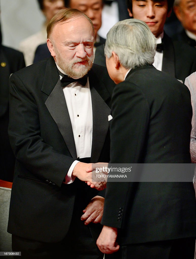 Professor Jean M. J. Frechet (L) of the US is congratulated by Japanese Emperor Akihito (R) during the awards ceremony for the Japan Prize in Tokyo on April 24, 2013. Frechet and his compatriot, Professor C. Grant Wilson, were jointly awarded the prize in the materials and production field to develop chemically amplified resistant polymer materials for the innovative semiconductor manufacturing process. The Japan Prize is awarded annually to scientists and engineers from around the world who have made significant contributions to the advancement of science and technology, furthering the cause of peace and prosperity. AFP PHOTO/Toru YAMANAKA