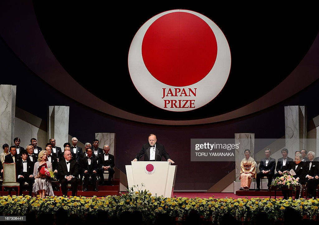 Professor Jean M. J. Frechet of the US (C) makes a speech during the awards ceremony for the Japan Prize in Tokyo on April 24, 2013. Frechet and his compatriot, Professor C. Grant Wilson, were jointly awarded the prize in the materials and production field to develop chemically amplified resistant polymer materials for the innovative semiconductor manufacturing process. The Japan Prize is awarded annually to scientists and engineers from around the world who have made significant contributions to the advancement of science and technology, furthering the cause of peace and prosperity. AFP PHOTO/Toru YAMANAKA
