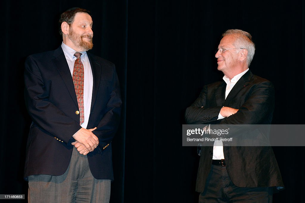 Professor Jean-Jacques Rein and Bernard Murat on stage after the Ary Abittan performance at Theater Edouard VII benefiting 'Un Coeur Pour La Paix' on June 24, 2013 in Paris, France.