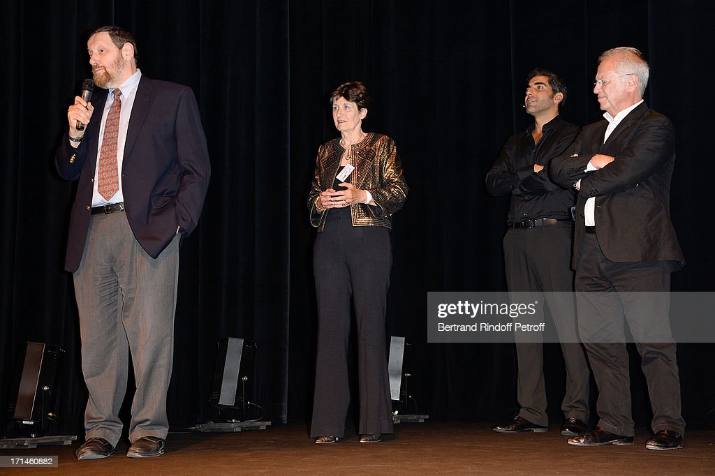 Professor Jean-Jacques Rein, president of association 'Un Coeur Pour La Paix' Muriel Haim, Ary Abittan and Bernard Murat on stage after the Ary Abittan performance at Theater Edouard VII benefiting 'Un Coeur Pour La Paix' on June 24, 2013 in Paris, France.