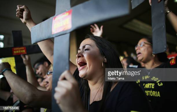 Professor Karen Rabelo and other education workers chant during a protest calling for improved pay and working conditions in Rio de Janeiro Brazil on...