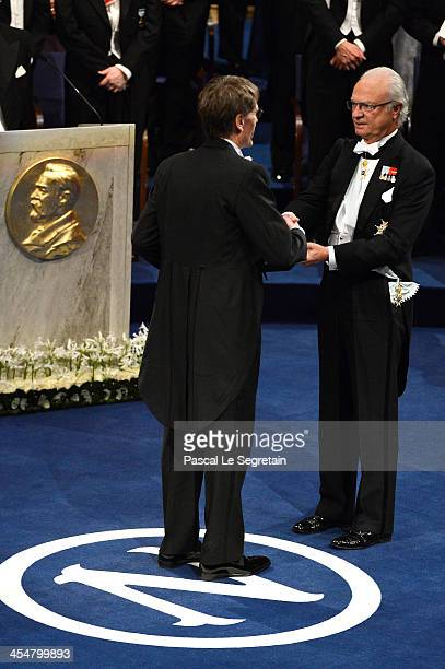 Professor Lars Peter Hansen laureate of The Sveriges Riksbank Prize in Economic Sciences in Memory of Alfred Nobel receives his Nobel Prize from King...