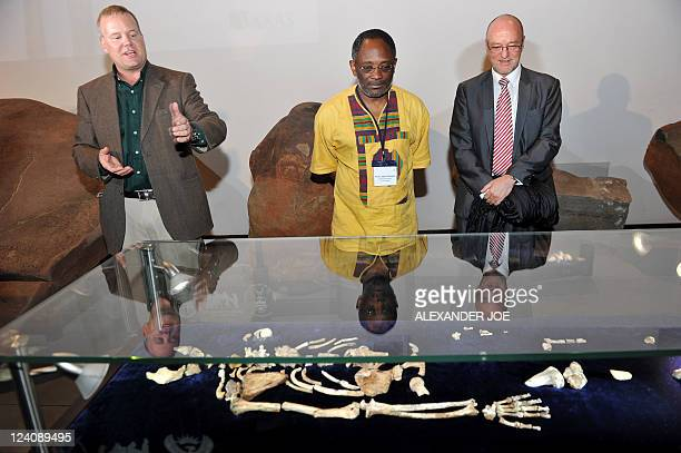 Professor Lee Berger an American who is a professor at South Africa's University of the Witwatersrand talks beside Professor Loyiso Nongxa...