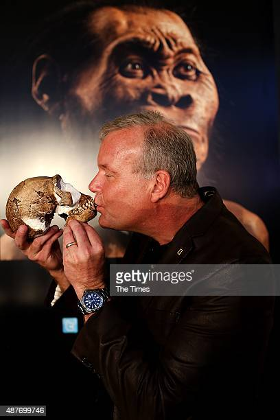 Professor Lee Berger kisses the skull during the reveal of the discovery of a new species of a human relative Homo Naledia at The Cradle of Human...