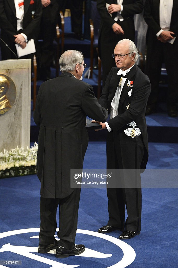 Professor <a gi-track='captionPersonalityLinkClicked' href=/galleries/search?phrase=Martin+Karplus&family=editorial&specificpeople=11457248 ng-click='$event.stopPropagation()'>Martin Karplus</a> (L), laureate of the Nobel Prize in Chemistry receives his Nobel Prize from King Carl XVI Gustaf of Sweden (R) during the Nobel Prize Awards Ceremony at Concert Hall on December 10, 2013 in Stockholm, Sweden.