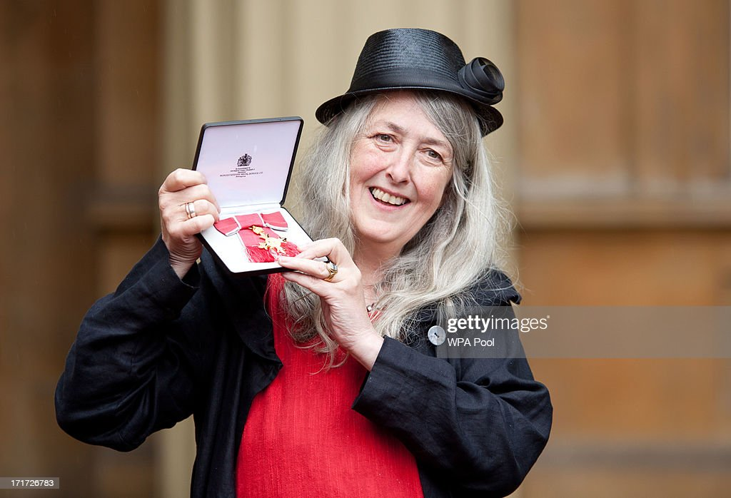 Professor Mary Beard, professor of Classics at Cambridge University, with her OBE for services to Classical Scholarship after she received the award from Prince Charles, Prince of Wales during an Investiture ceremony at Buckingham Palace on June 28, 2013 in London, England. Mo Farah will receive an CBE for services to Athletics.