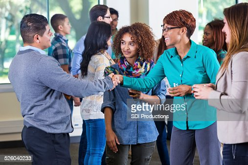 Professor meeting student and parents during orientation at school