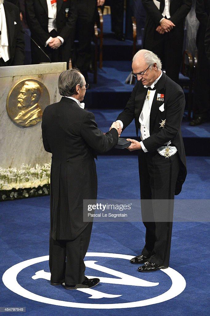 Professor Michael Levitt (L), laureate of the Nobel Prize in Chemistry receives his Nobel Prize from King Carl XVI Gustaf of Sweden (R) during the Nobel Prize Awards Ceremony at Concert Hall on December 10, 2013 in Stockholm, Sweden.