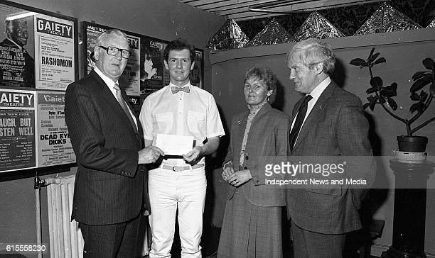 Professor Michael O'Halloran chairman of the Friends of St Luke's Appeals Fund being presented a cheque in the Gaiety Theatre by Aer Lingus 737...
