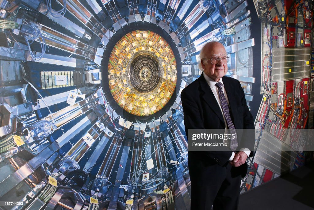 Professor <a gi-track='captionPersonalityLinkClicked' href=/galleries/search?phrase=Peter+Higgs+-+Physicist&family=editorial&specificpeople=11508863 ng-click='$event.stopPropagation()'>Peter Higgs</a> stands in front of a photograph of the Large Hadron Collider at the Science Museum's 'Collider' exhibition on November 12, 2013 in London, England. At the exhibition, which opens to the public on November 13, 2013 visitors will see a theatre, video and sound art installation and artefacts from the Large Hadron Collider, providing a behind-the-scenes look at the CERN particle physics laboratory in Geneva. It touches on the discovery of the Higgs boson, or God particle, the realisation of scientist <a gi-track='captionPersonalityLinkClicked' href=/galleries/search?phrase=Peter+Higgs+-+Physicist&family=editorial&specificpeople=11508863 ng-click='$event.stopPropagation()'>Peter Higgs</a> theory.