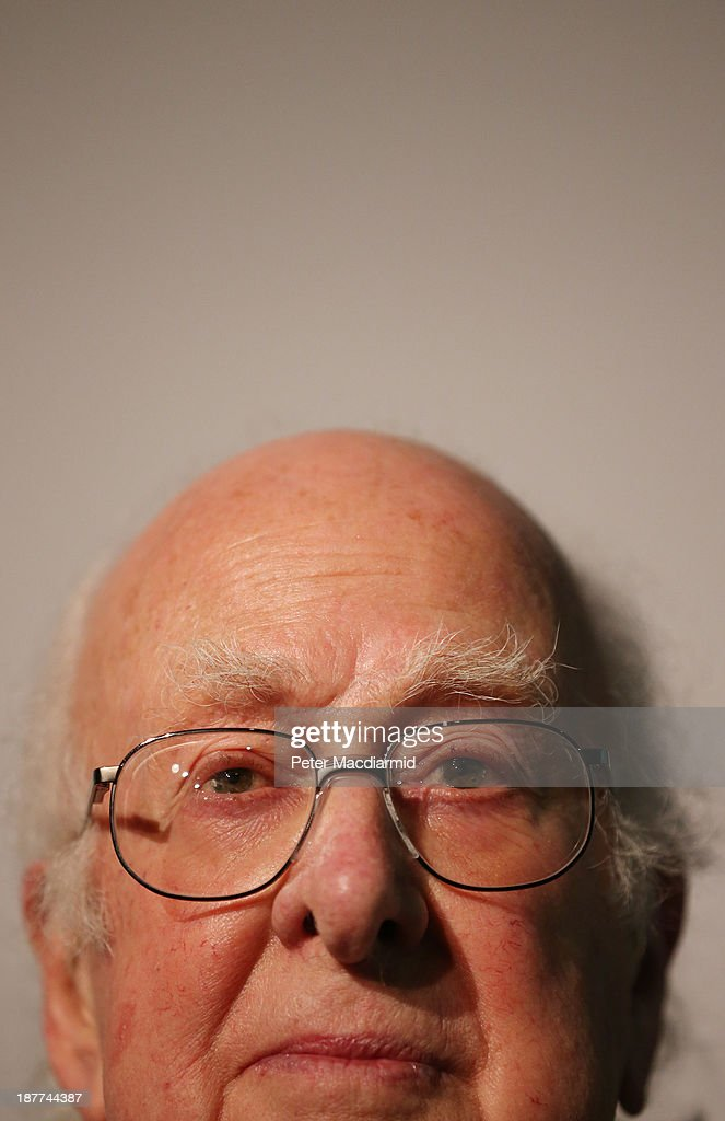 Professor Peter Higgs visits the Science Museum's 'Collider' exhibition on November 12, 2013 in London, England. At the exhibition, which opens to the public on November 13, 2013 visitors will see a theatre, video and sound art installation and artefacts from the Large Hadron Collider, providing a behind-the-scenes look at the CERN particle physics laboratory in Geneva. It touches on the discovery of the Higgs boson, or God particle, the realisation of scientist Peter Higgs theory.
