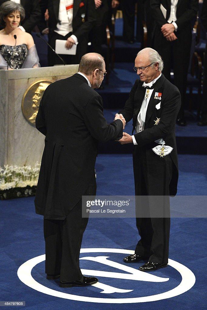 Professor Randy W. Schekman (L), laureate of the Nobel Prize in Physiology or Medicine receives his Nobel Prize from King Carl XVI Gustaf of Sweden (R) during the Nobel Prize Awards Ceremony at Concert Hall on December 10, 2013 in Stockholm, Sweden.