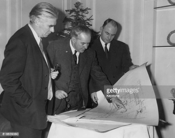 Professor Robert Matthew the architect of the new New Zealand House to be built on the Mall in London discusses his plan with Clarence Skinner the...