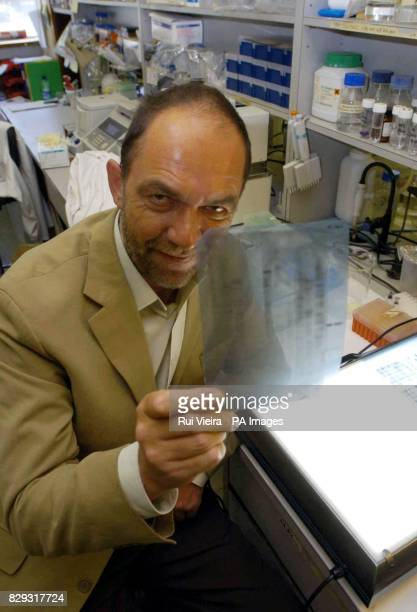 Professor Sir Alec Jeffreys show a copy of the first DNA fingerprint profile on the 20th anniversary of the revolutionary technique that he...