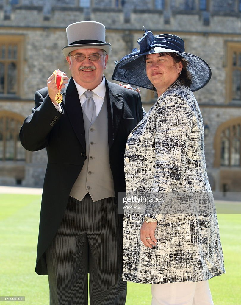 Professor Sir Stephen O'Rahilly from Cambridge with his sister Helen O'Rahilly after being knighted by Queen Elizabeth II during an Investiture ceremony at Windsor Castle on July 19, 2013 in Windsor, England.