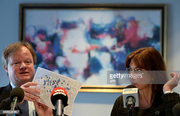 Professor Stefaan Van Gool of UZ Leuven university flanked by Professor Nadine Francotte from CHC clinic in Liege shows a map during a press...