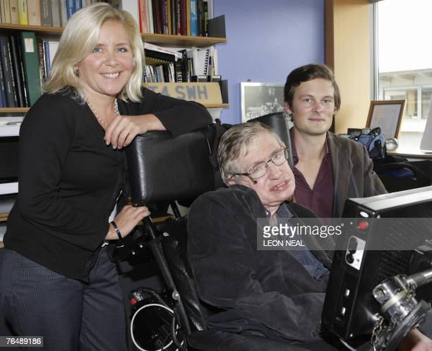 Professor Stephen Hawking his daughter Lucy and Christophe Galfard pose for photographs in Professor Hawking's office at The Centre for Mathematical...