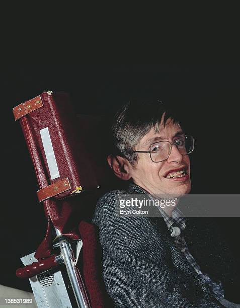 Professor Stephen Hawking poses for a photograph in his office at the University of Cambridge in Cambridge UK in April 1991 Hawking has written...