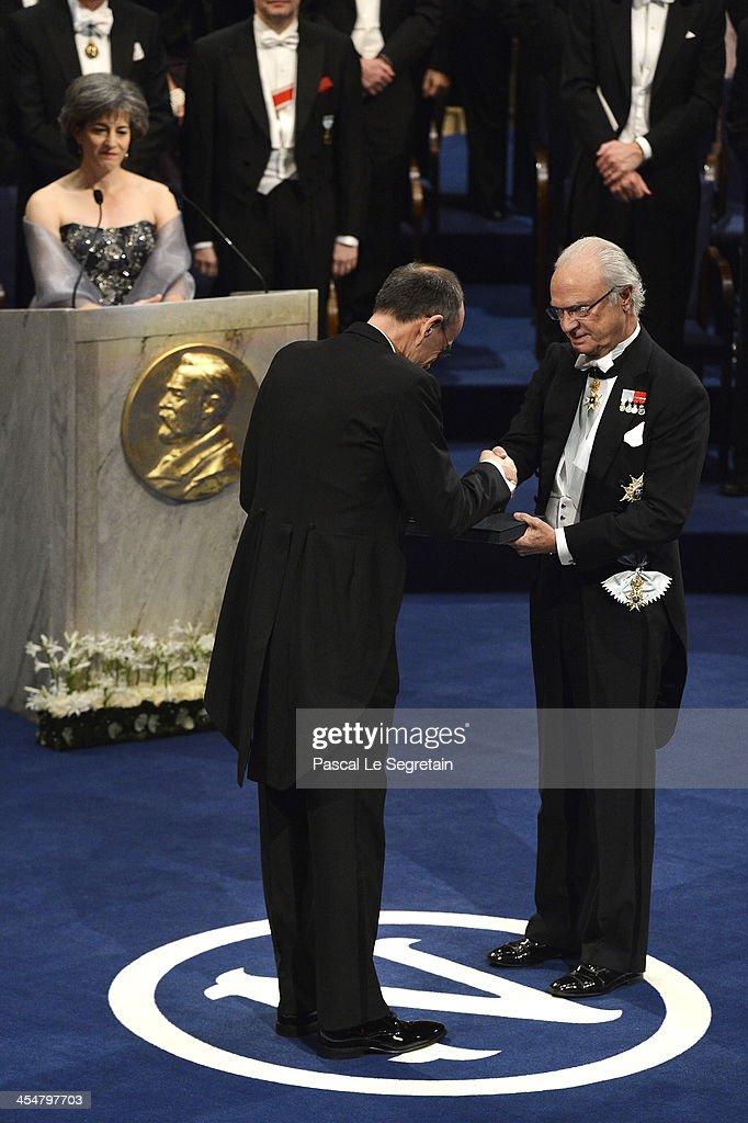 Professor Thomas C. Sudhof (L), laureate of the Nobel Prize in Physiology or Medicine receives his Nobel Prize from King Carl XVI Gustaf of Sweden (R) during the Nobel Prize Awards Ceremony at Concert Hall on December 10, 2013 in Stockholm, Sweden.