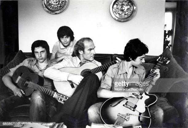 Professor Umberto Veronaesi plays guitar with his three sons Alberto Paolo and Giulia Milan 1976