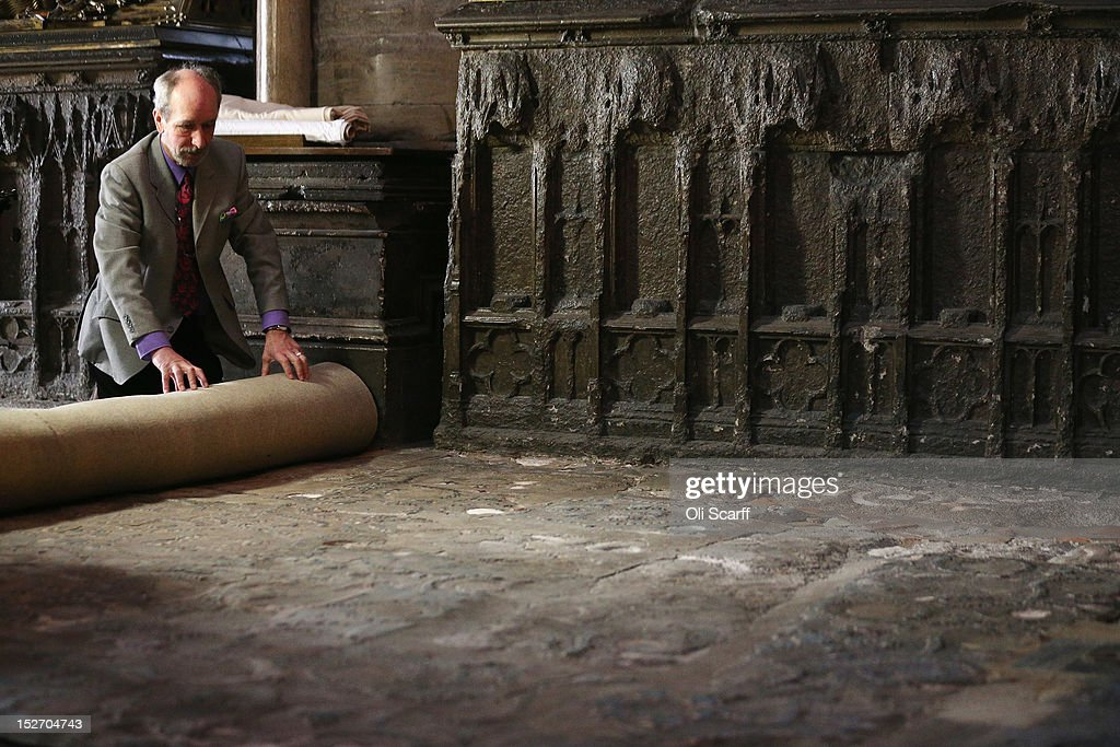 Professor Warwick Rodwell, Westminster Abbey's Archaeologist, examines the Cosmati pavement surrounding the tomb of Edward the Confessor to asses it for conservation after the removal of its protective covering on September 24, 2012 in London, England. The highly decorative stone pavement is formed of small precious stones such as onyx and porphyry on a base of dark limestone, known as Purbeck marble. A shrine was erected in 1163 following the Confessor's canonisation and St Edward's body was brought in on October 13, 1269 to its new resting place.The Cosmati pavement provides the flooring around Edward the Confessor's tomb behind the High Altar of Westminster Abbey where the Duke and Duchess of Cambridge signed their marriage register. The pavement's protective covering has only been raised a small number of times in the past 100 years.