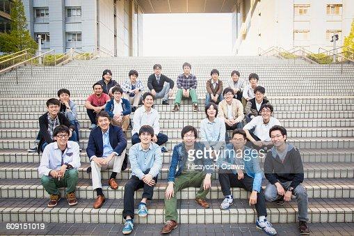 Professor with Students on Steps : ストックフォト