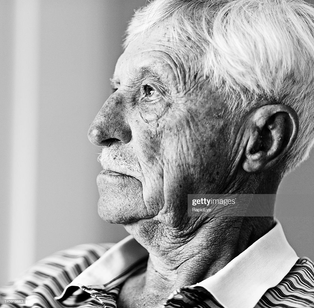 profile black and white portrait of serious old man stock
