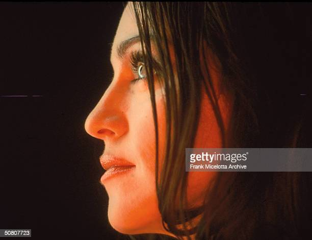 Profile headshot of American pop singer Madonna as she performs during the video shoot for her single 'The Power Of Goodbye' 1998