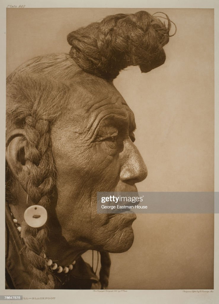 Profile headshot portrait of a Native American from the Blackfoot people named 'Bear Bull,' 1926.