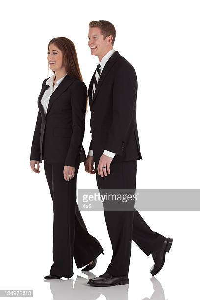 Profile of a business couple laughing