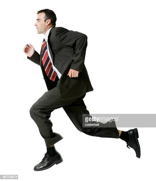 Profile of a businessman running