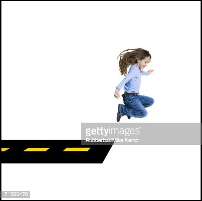 Profile of a girl jumping off the road : Stockfoto