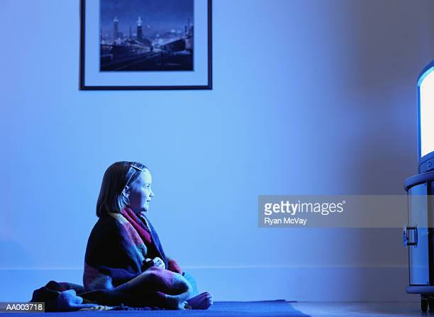 Profile of a Girl Watching Television