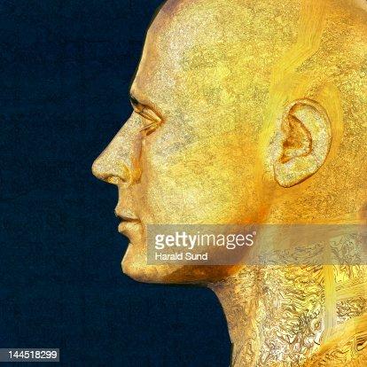 Profile of a golden metallic male head : Foto de stock