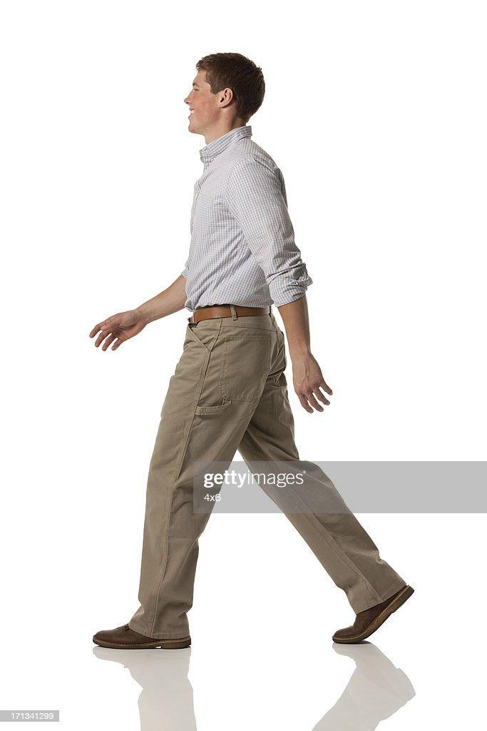 Profile of a happy man walking