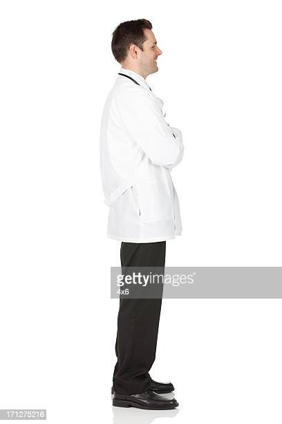 Profile of a male doctor standing with his arms crossed