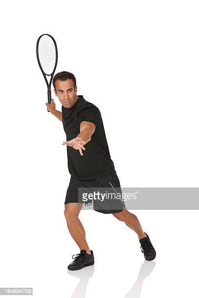 Profile of a man playing tennis