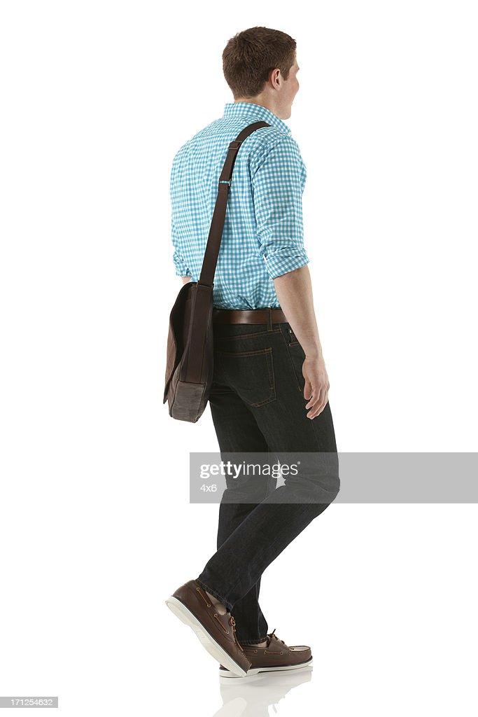 Profil von ein Mann zu Fuß : Stock-Foto